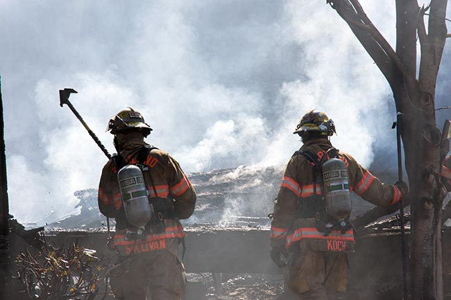 Widland firefighters at a forest fire - smoke jumpers were participants in a clinical trial showing that electrolyte drops in water improved hydration