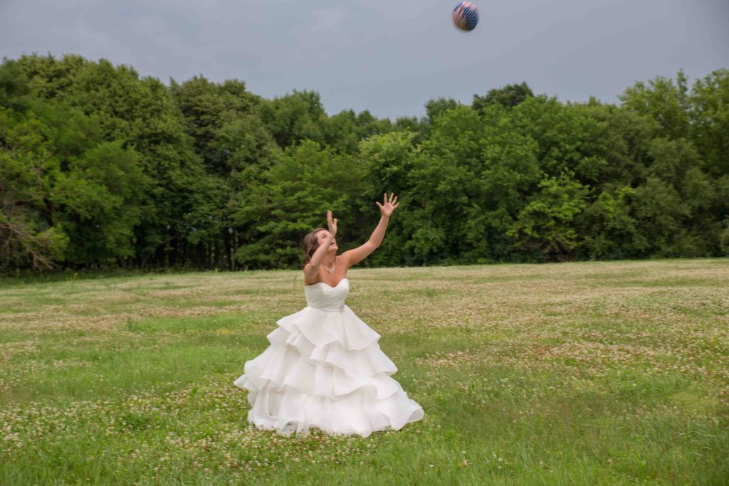 Bride catching a football