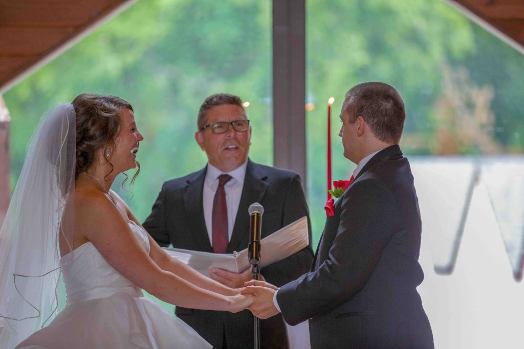 Bride Groom and Pastor wedding ceremony