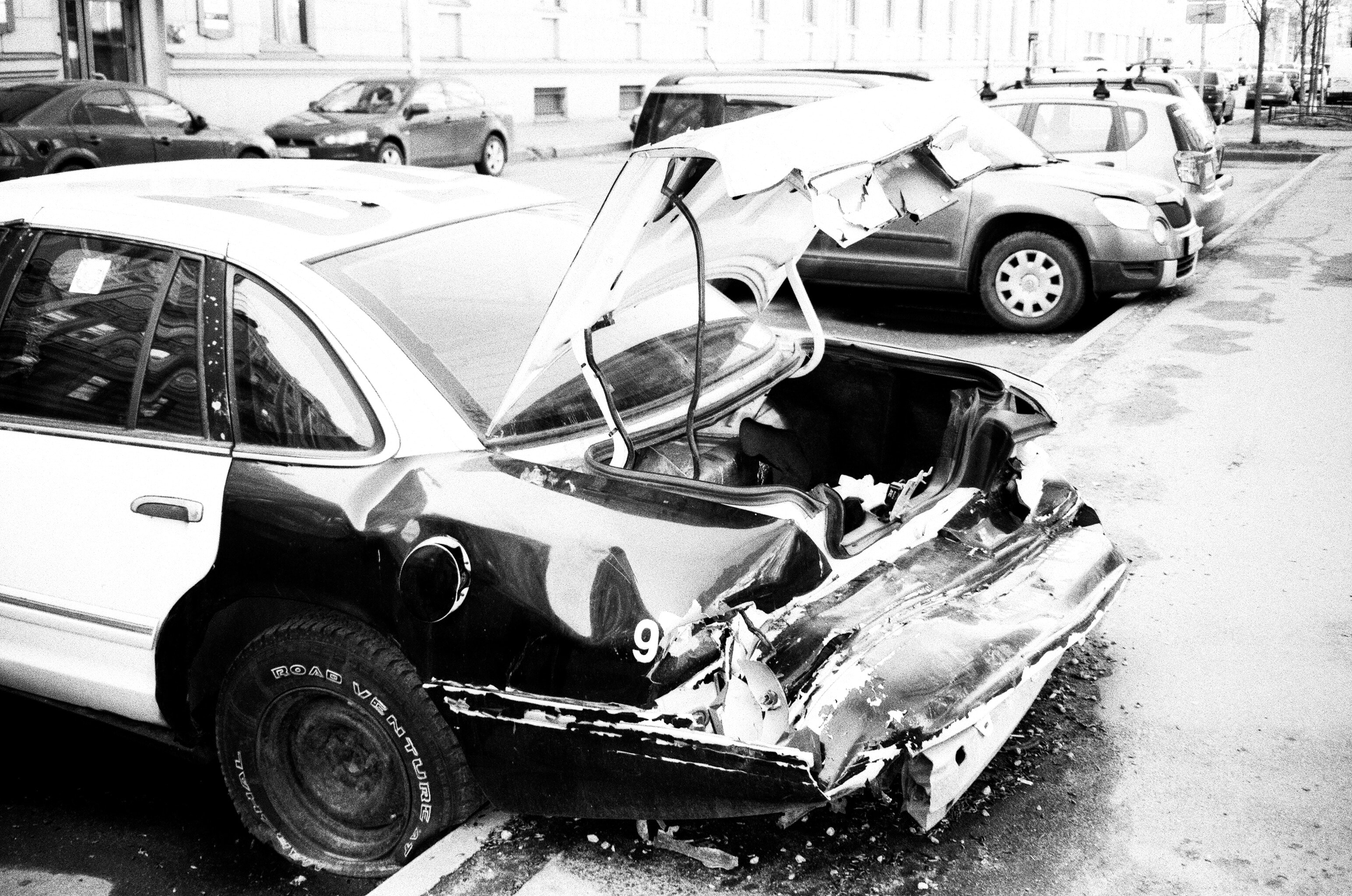 black and white wrecked car