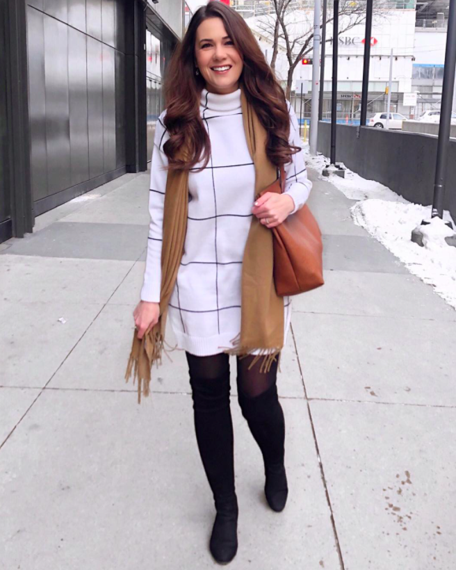 chicwish blogger wearing the grid print dress with black stockings, black boots, a brown scarf, and a brown abg