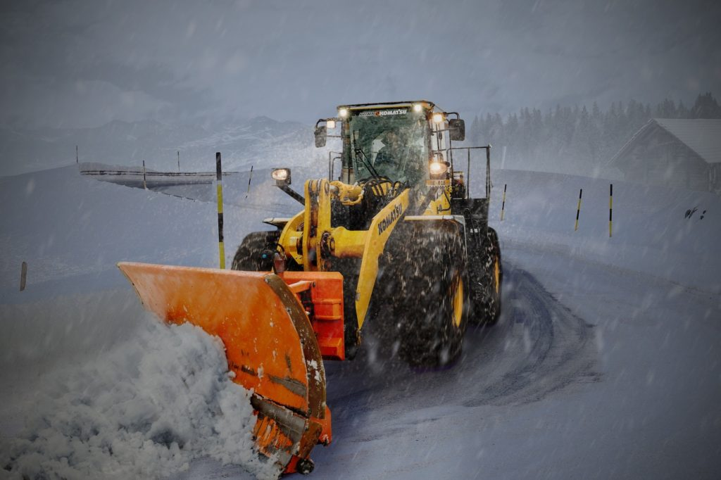 Commercial snow clearing service plowing snow