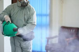 Worker spraying disinfectant spray