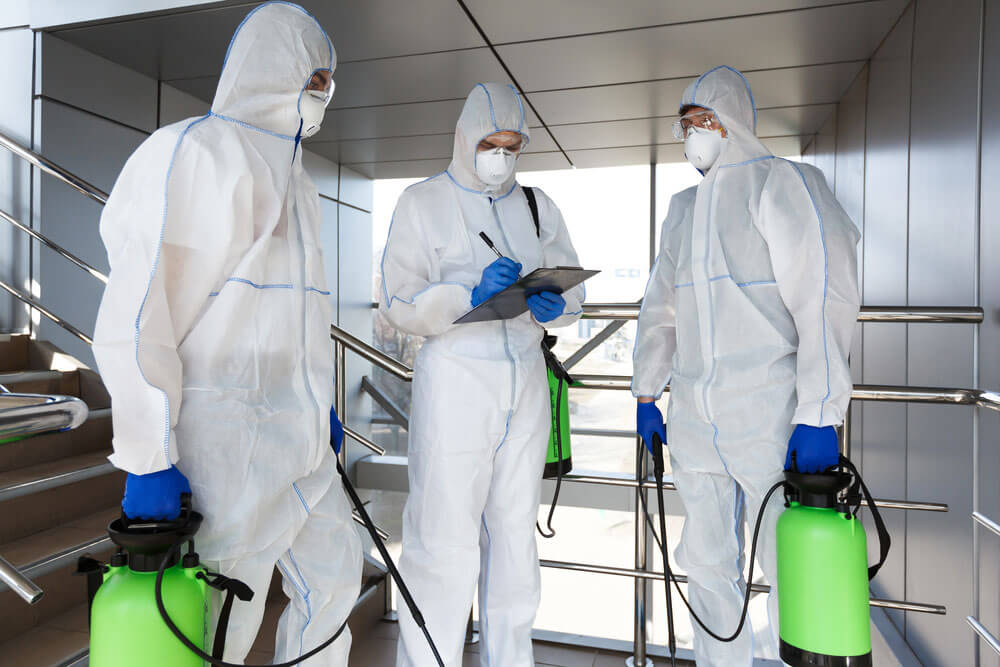 Budd Group workers disinfecting for COVID-19