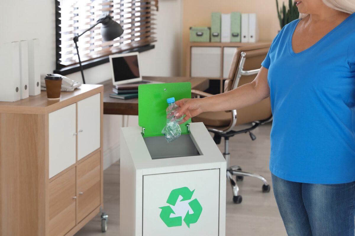 Woman recycling a water bottle
