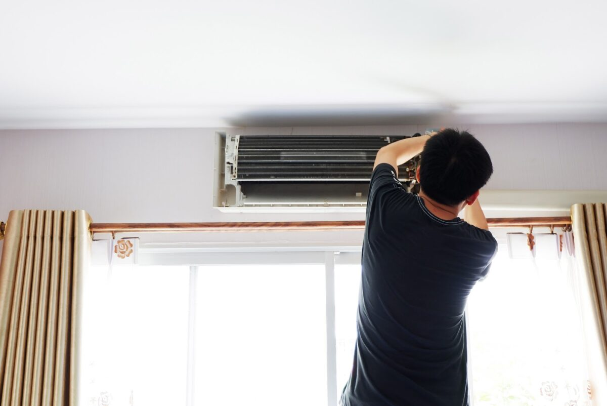 Person working on the AC in their condo
