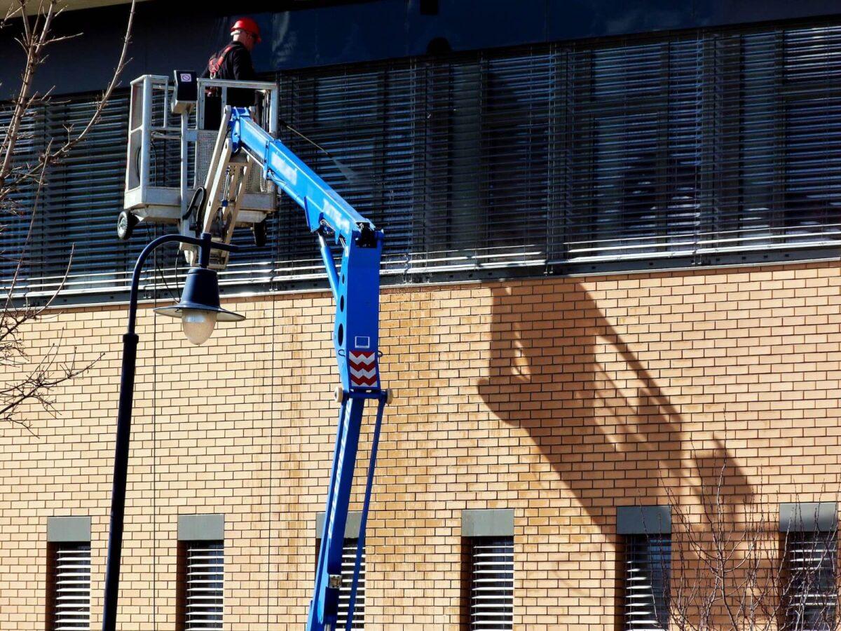 Pressure washing a building in Birmingham, AL