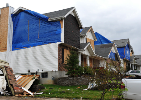 Covered up home after storm damage