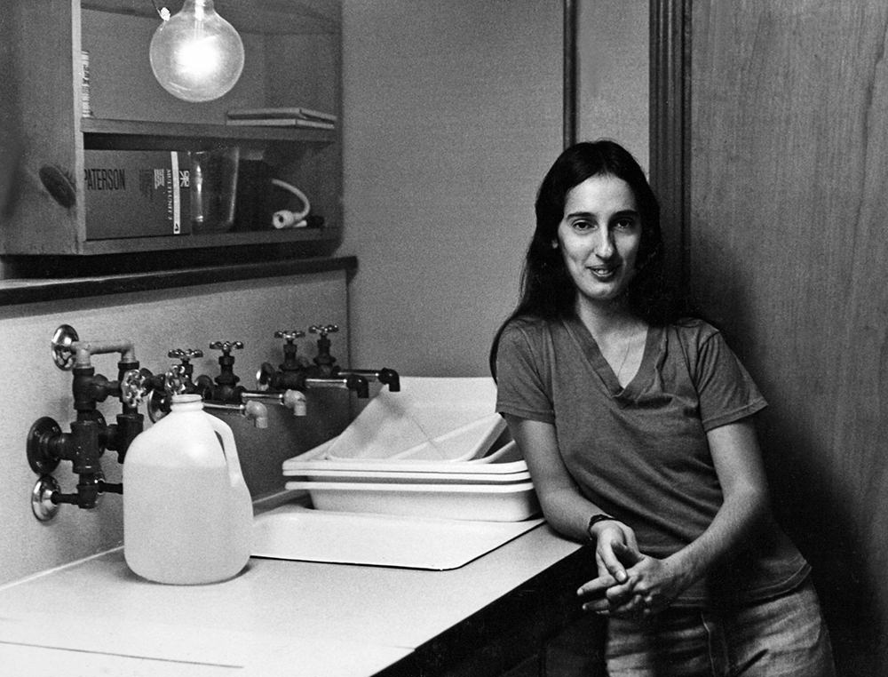 Irene Young in darkroom, 1972, by David Payne.