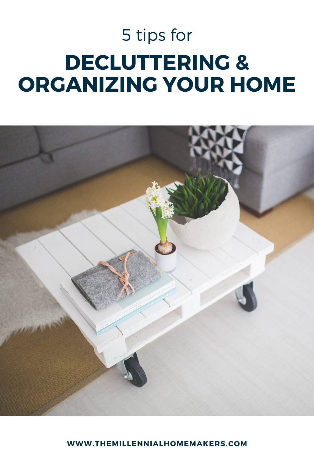 white coffee table with plants and books