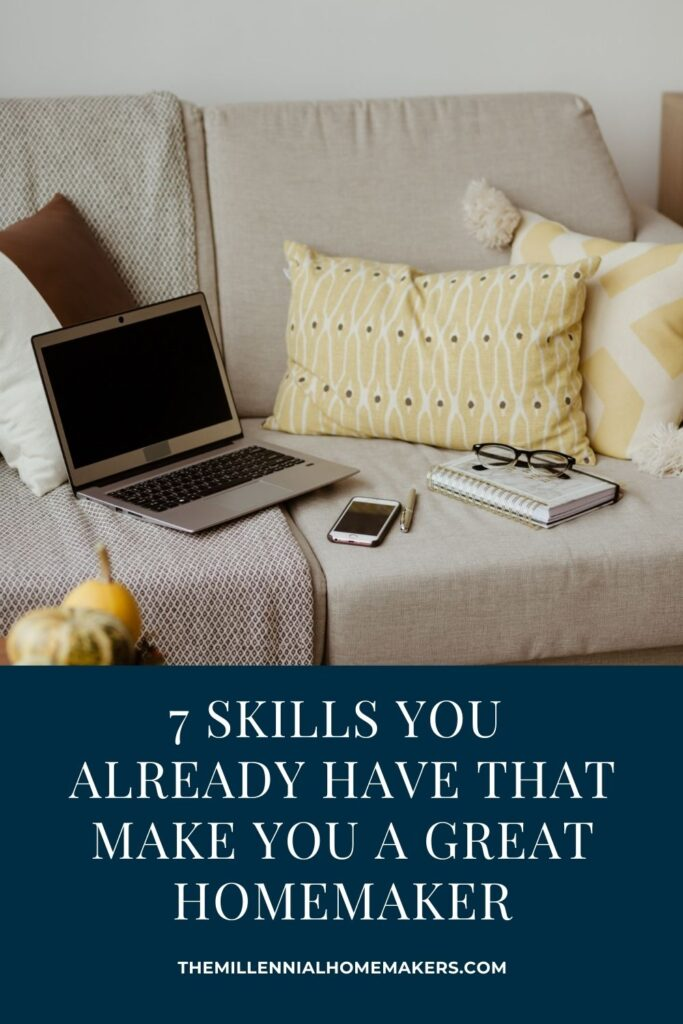 open laptop, cell phone, and planner on a neutral sofa with throw pillows