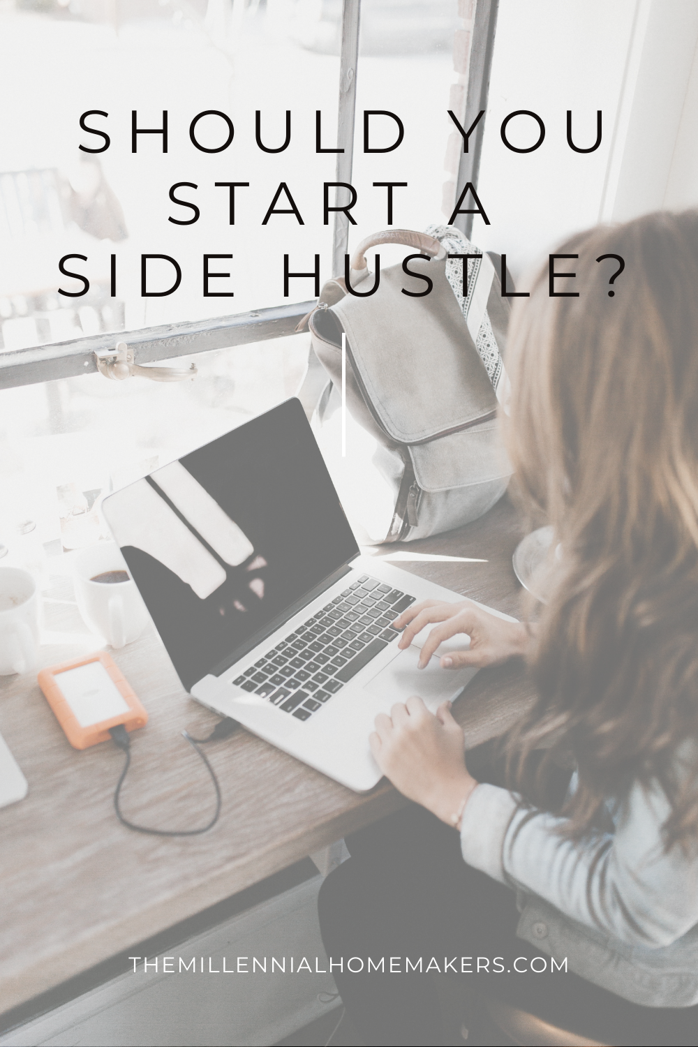 woman using laptop to work on her side hustle