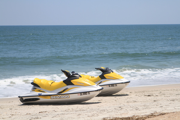 Jet skis on the beach in the surf