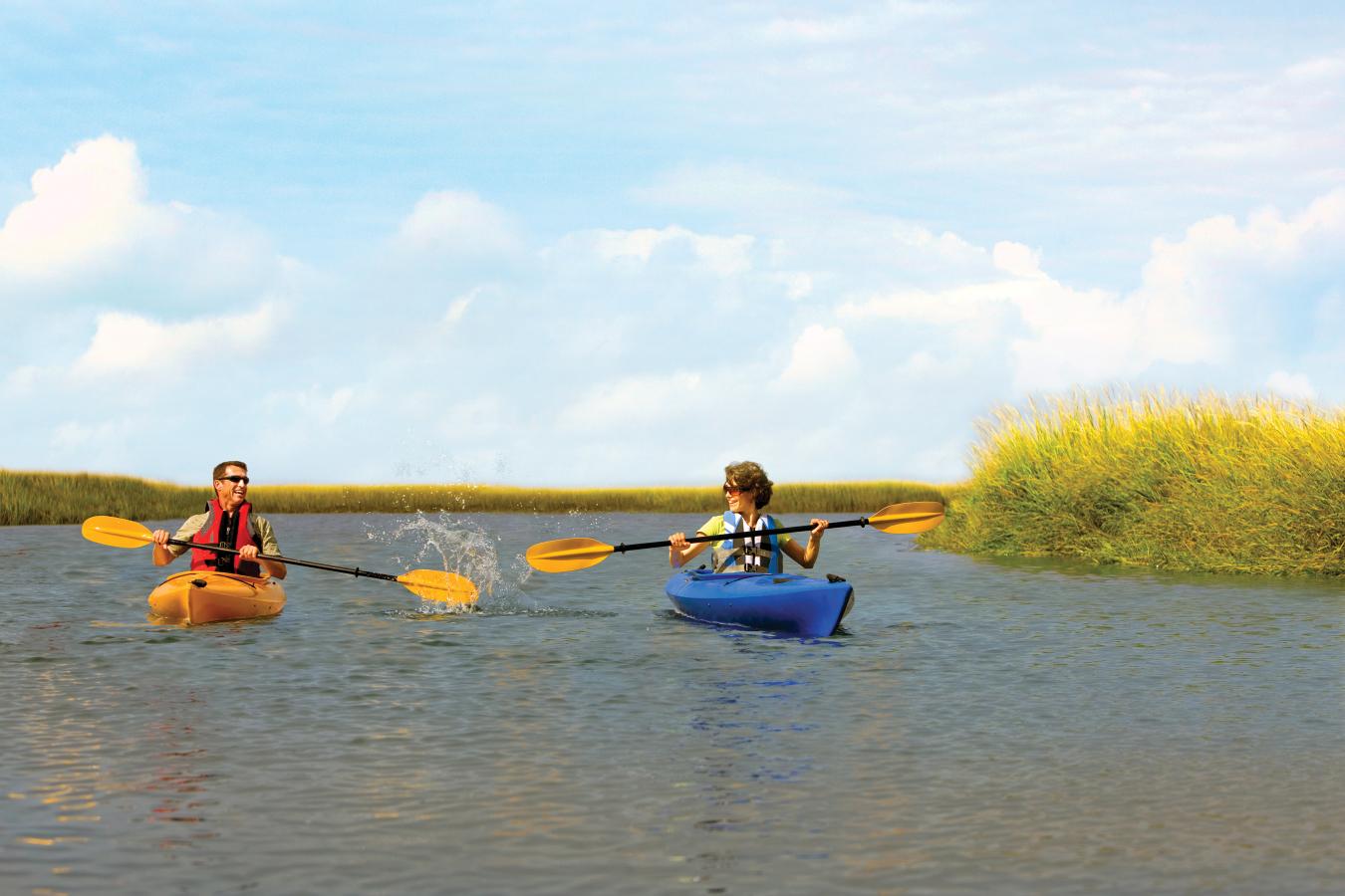 Amelia Island Kayak couple kayaking in marsh