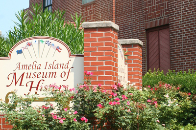 Amelia Island Museum of History sign and flowers