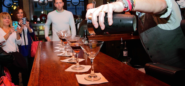 Palace Saloon Cocktail Tour bartender pouring martinis