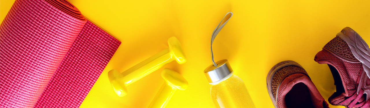 Workout equipment on yellow background