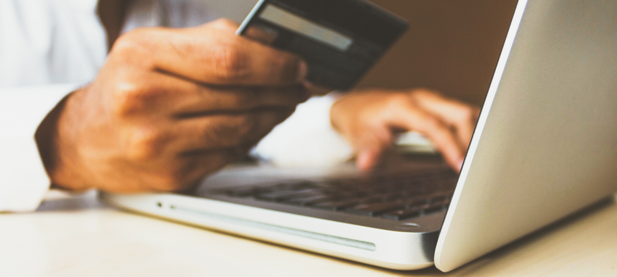 Man holding credit card shopping online