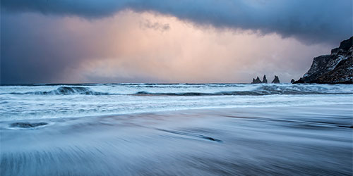 Sunset on the beach in Vik Iceland