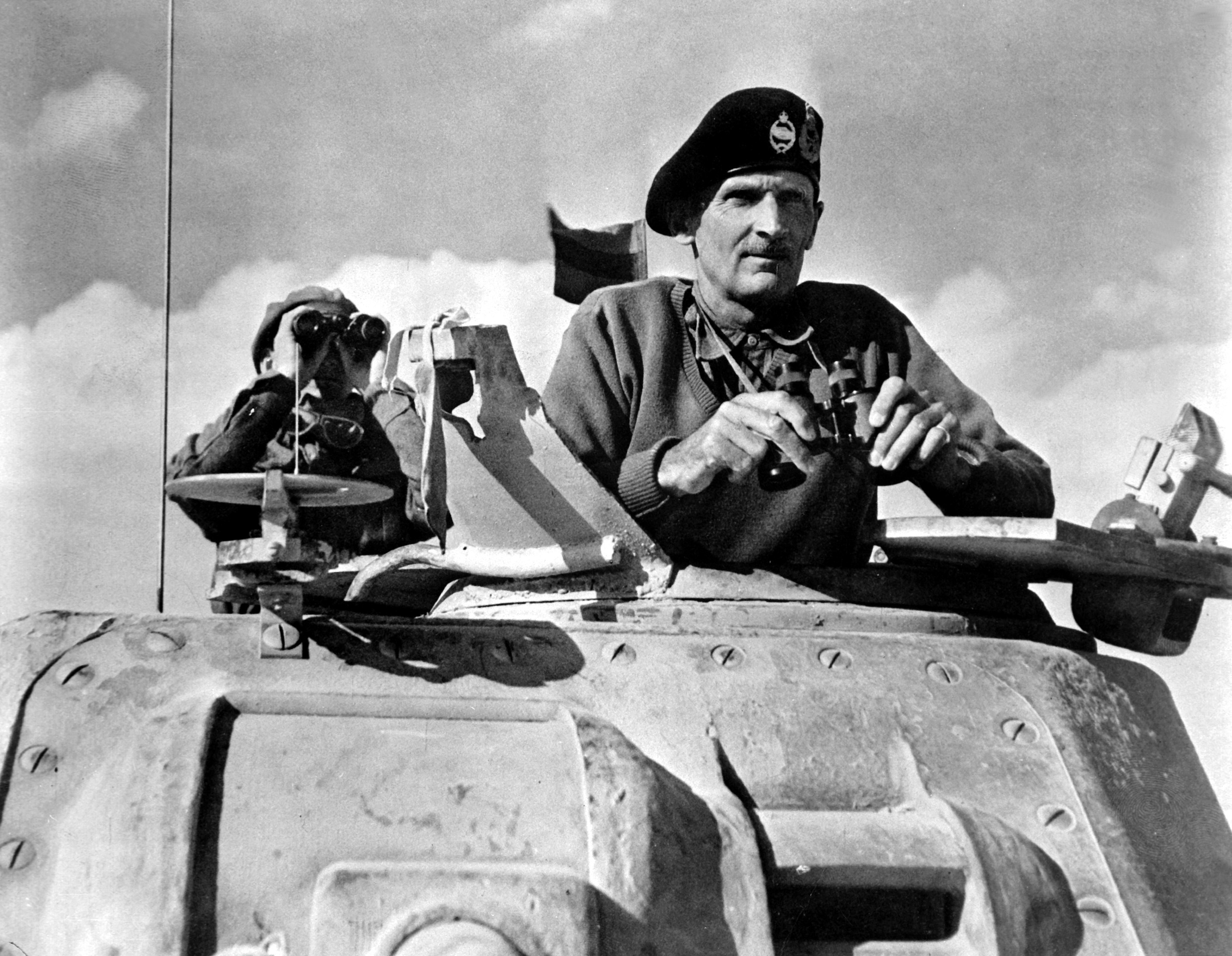 General Bernard L. Montgomery watches his tanks move up in North Africa campaign, November 1942.