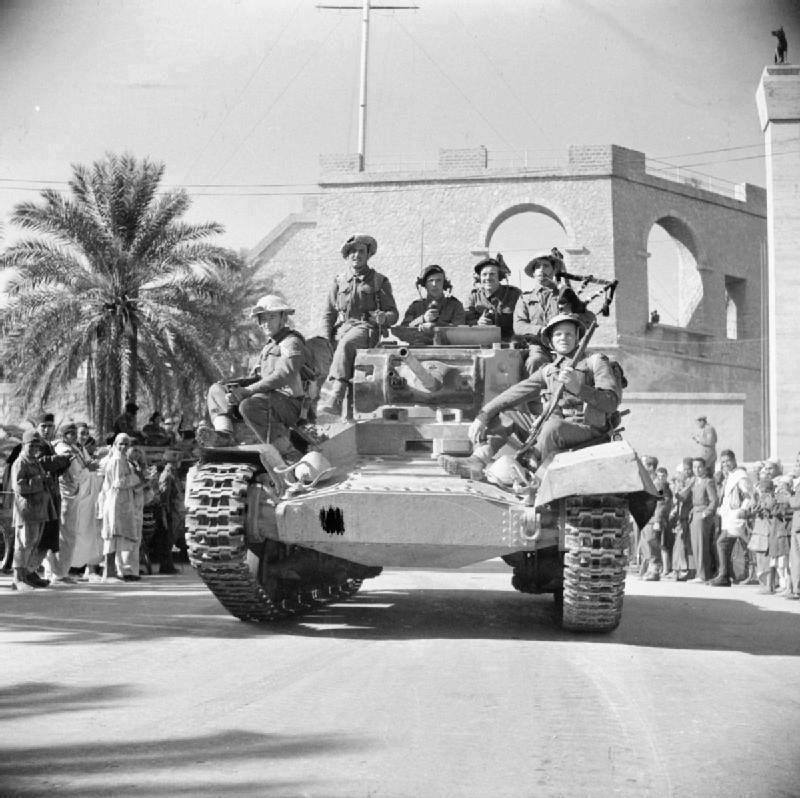 British armored vehicle enters Tripoli, 1943.