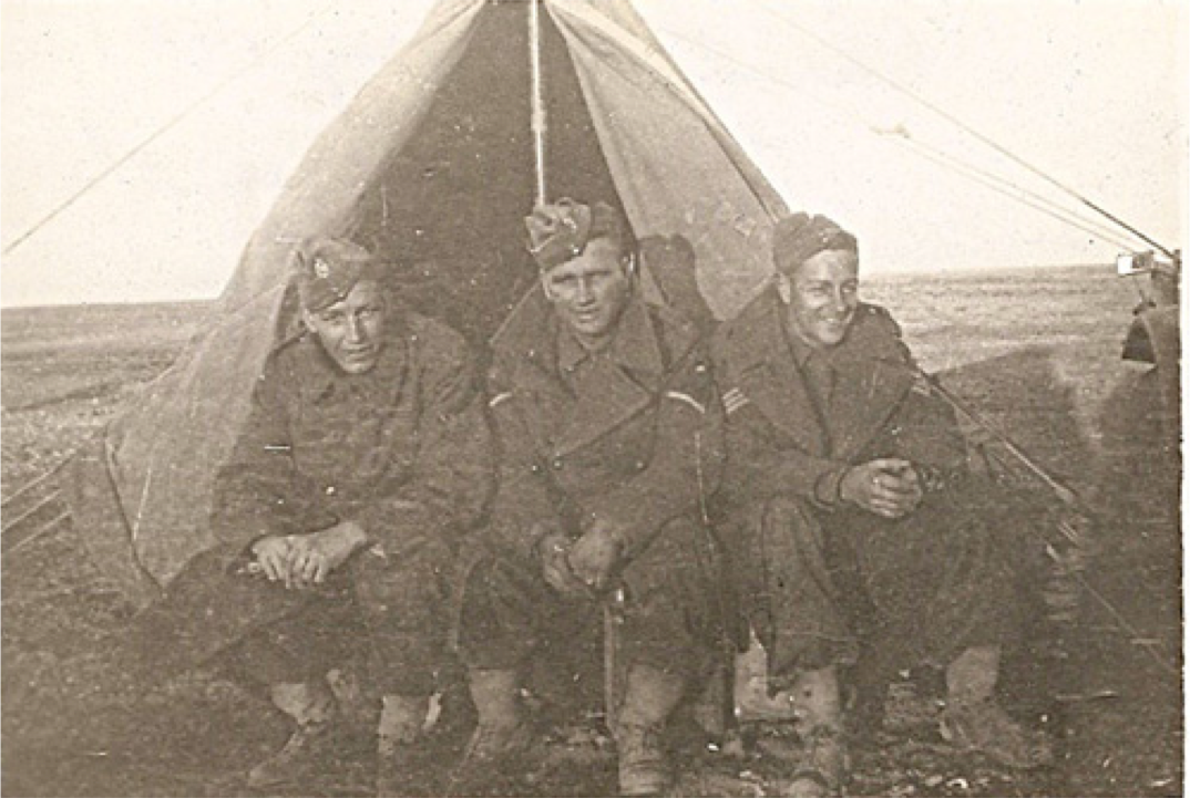Three soldiers in tent, N. African desert, Christmas 1941.