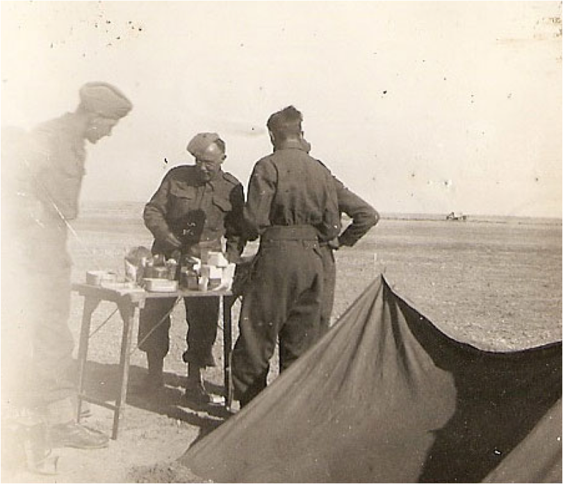 British soldiers cook a meal in N. African desert, 1941
