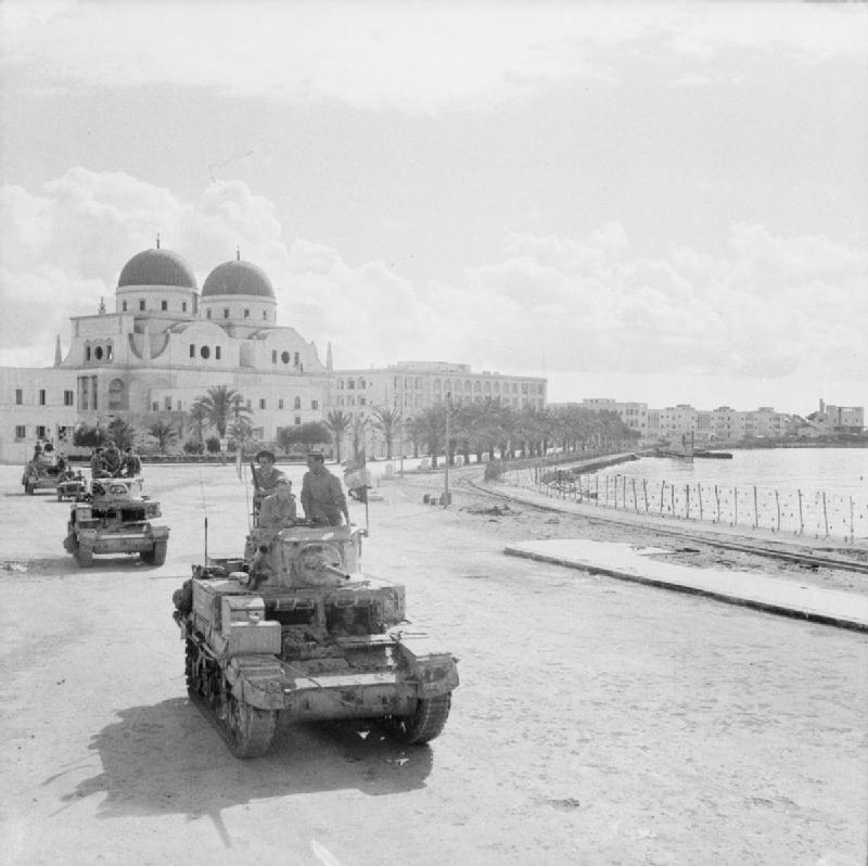 Stuart tanks proceed along the waterfront in Benghazi, November 1942.