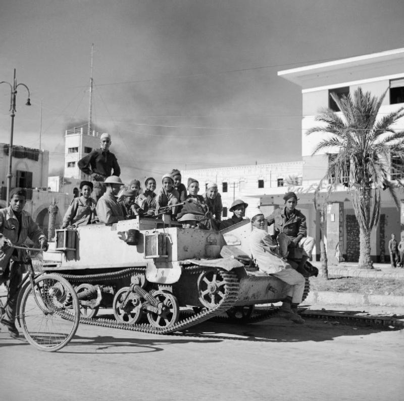 Local children are given a ride on a Bren gun carrier in Benghazi, November 1942.