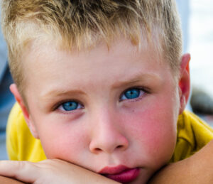 Canva - Close-Up Photography of Boy With Blue Eyes