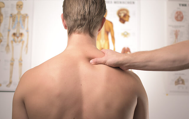 Man from behind with doctors hand on shoulder
