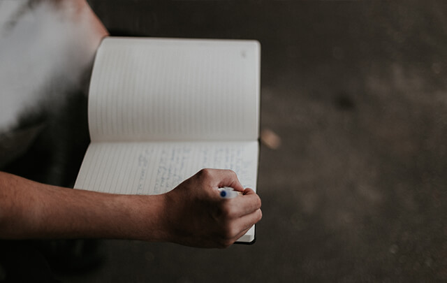 Male addict writing in a journal