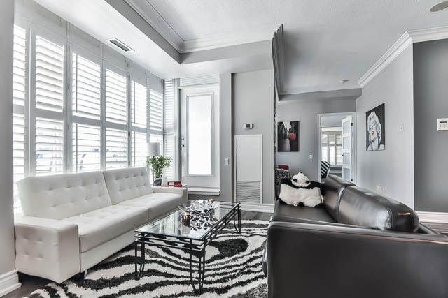 White Leather Couch and Black Leather Couch