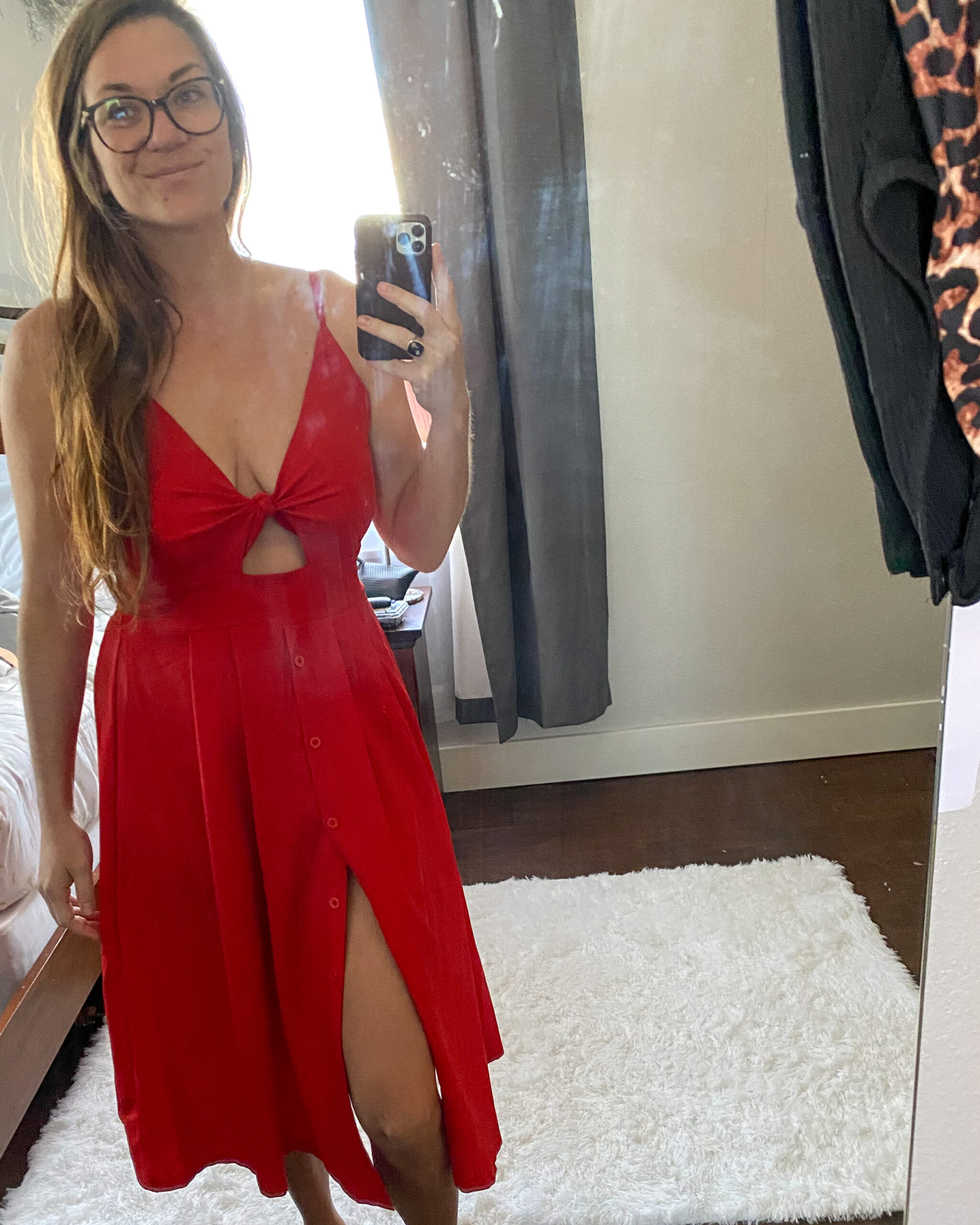 photo of a girl in a red dress text how to tape big boobs