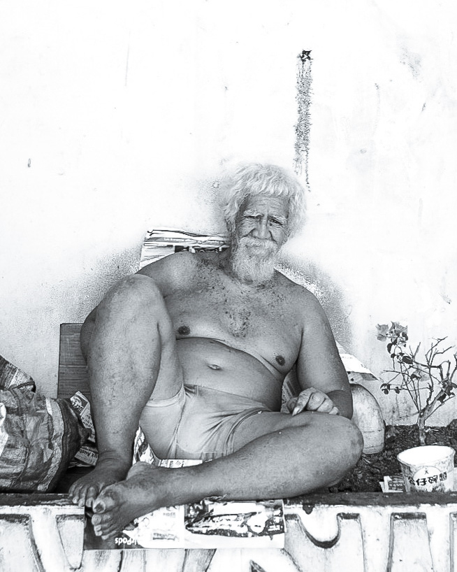 Black and white Photo of a homeless man on the streets of Papetee, Tahiti, French Polynesia