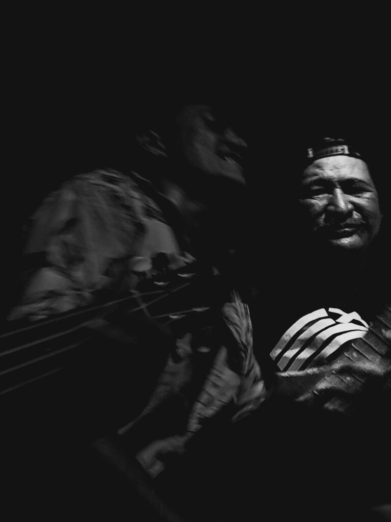 Black and white photo of two tahitians singing