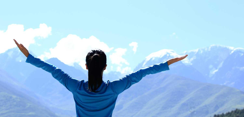 hiking-woman-enjoy-the-beautiful-view-at-mountain-peak