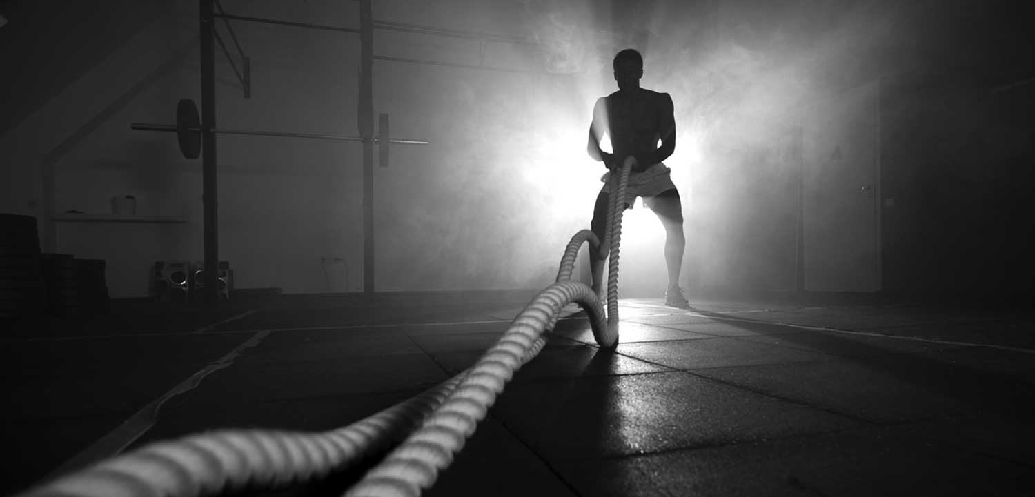 man-with-long-ropes-in-gym