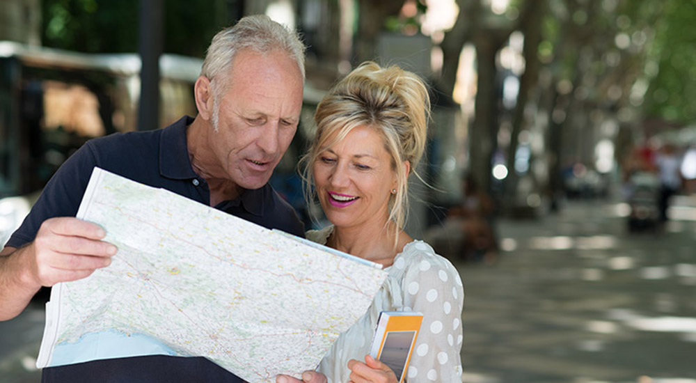 Couple reading a map on a trip