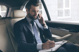 Business Man Working in Vehicle