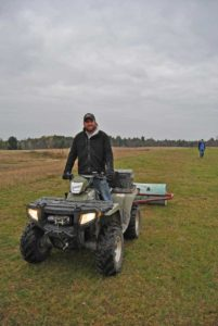 Darren Rolling the field at the Fall Clean Up and AGM