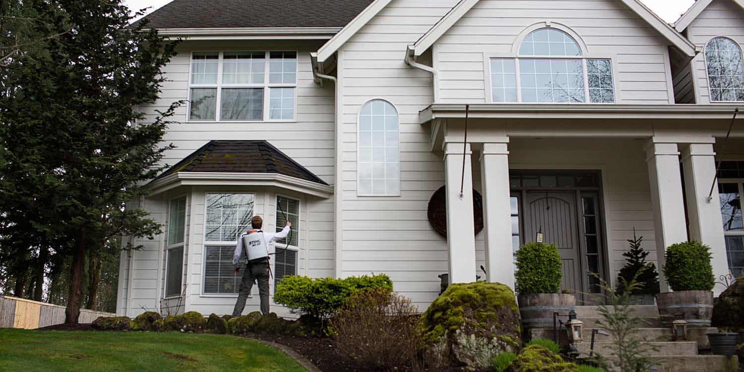 An exterminator rendering a pest control service at a residential home in Vancouver, WA