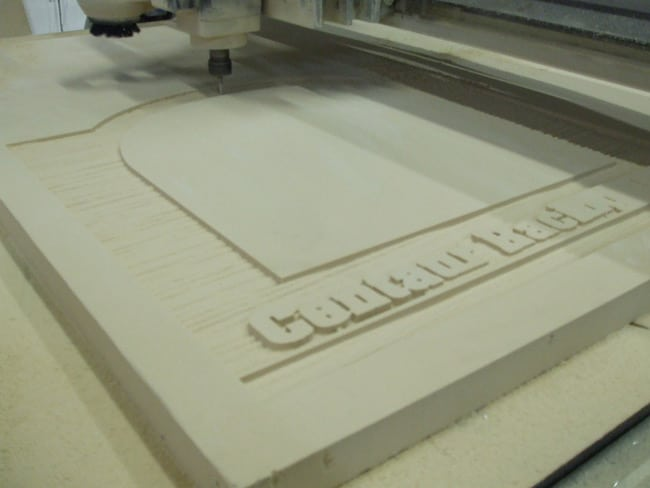 Monument sign being fabricated from HDU via CNC machine. Monument sign located in Atlanta.