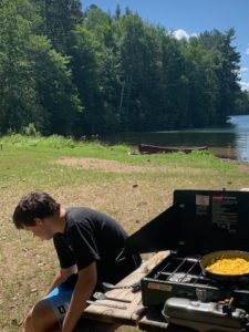Our Cable Area over-nighter features classic Northwoods cook outs, w/ canoe in the background a good egg breakfast provides energy for the day!