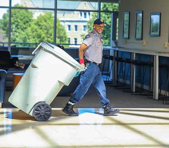 Man pulling shred bin