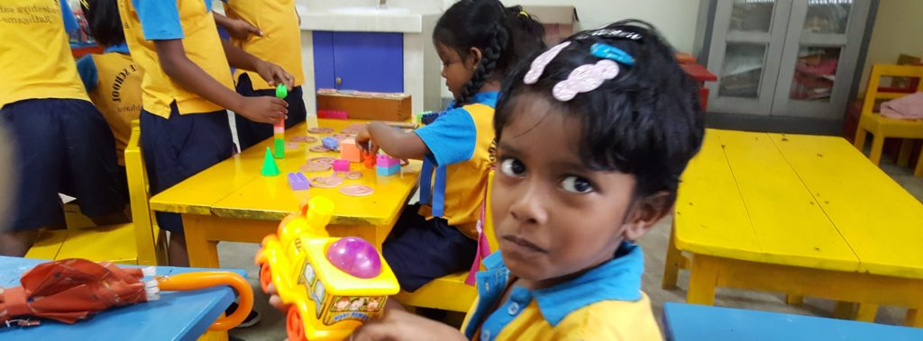Preschooler play with a bus