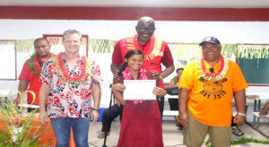 Marshalls Christian High School, located on the remote island of Rongrong in Majuro Atoll, completed a weeklong MIRCS-run first aid training, which ended with certificate ceremony joined by IFRC Secretary General Elhadj As Sy. In the photo, from left: MIRCS First Aid TrainerHarry Herming,MIRCS Secretary GeneralJack Niedenthal, first aid training graduate Asako Loeak showing off her certificate of completion, IFRC Secretary General Elhadj As Sy, and Majuro Mayor Ladie Jack. Photo: Roger Muller.