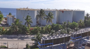 The eight tank MEC fuel farm at Delap, and the power plants in the foreground. Photo: Hilary Hosia.
