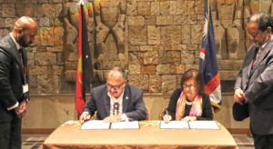 Papua New Guinea Prime Minister Peter O'Neill and RMI President Hilda Heine sign the new air services deal during the Pacific Leaders Meeting (PALM) in Japan last week. Photo: Marshall Islands President's Office.