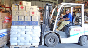 Warehouse forklift operator James Laidren maneuvers around a packed warehouse last week at the Marshall Islands Shipping Corporation warehouse at Uliga Dock. Photo: Hilary Hosia.